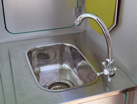 sink and water faucet in new modern kitchen interior Banco de Imagens