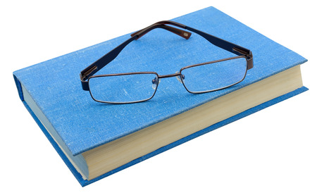 book with eyeglasses on a white background