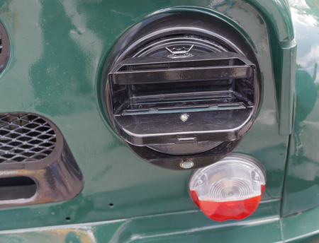 military car headlight with disguise closeup