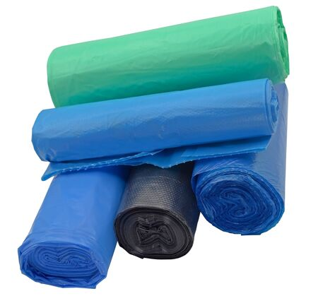 rolls of plastic packages for garbage on white background