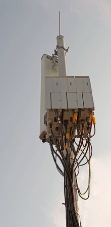Tower with aerials of cellular on a background sky 写真素材