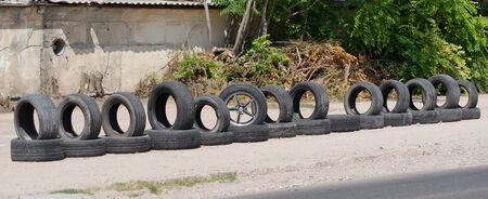 Car waste recycling, automotive industry. Rubbish along the road