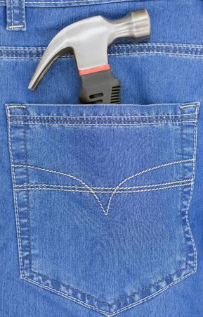 Hammer in new blue jeans pocket