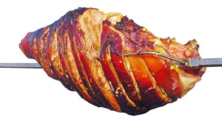 a large piece of pork carcass is roasted on a spit over a white background
