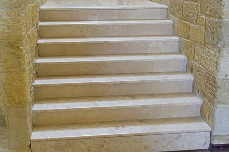 Old white marble steps and marble block walls Stock fotó