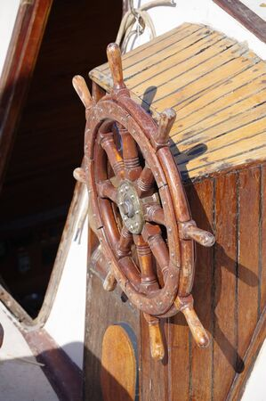 Old boat steering wheel from brass and wood