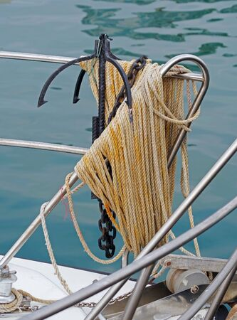 anchor and rope on prow of boat Stock Photo