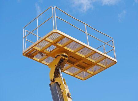 A cabin crane car to for in high area for safety and convenience work against the blue sky