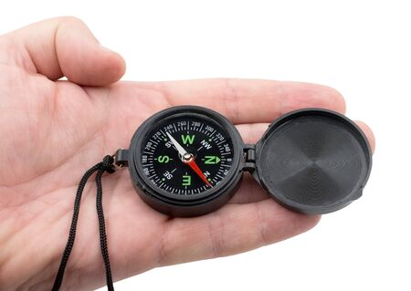 compass in hand on a white background close-up Standard-Bild - 133458037