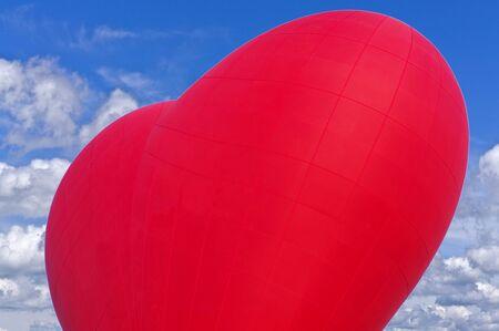 Heart shape balloon love symbol flying in the blue sky Stock fotó