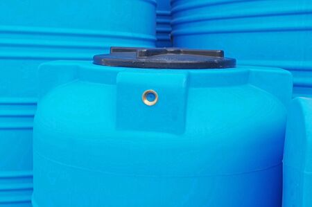 Blue plastic water and liquids barrel storage industrial containers Stock Photo