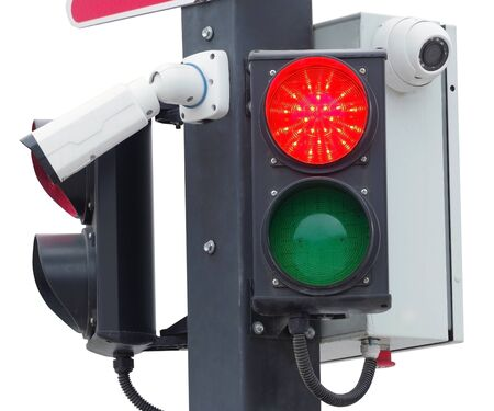 Security camera with traffic light on white background