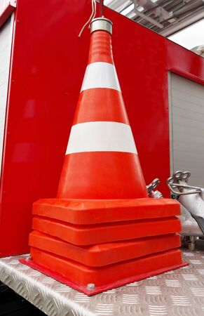 the new traffic cone with white and orange stripes