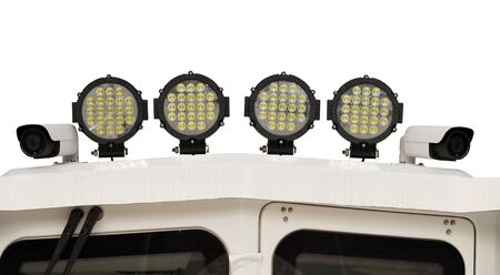 led spotlights and video surveillance camera on the boat on white background