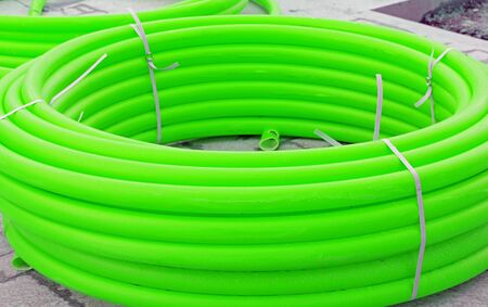 Many long green industrial plastic pipe for building