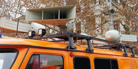 car with loudspeaker on the roof and LED lights. Closeup. Фото со стока - 140244597