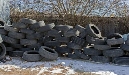 Pile of used car tire in the tire repair shop