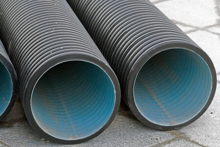 black plastic pipes for water supply or sewerage prepared for installation or repair of the water supply system