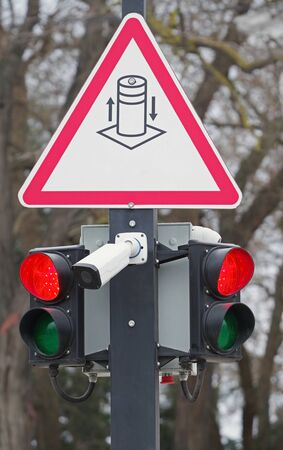 Security camera with traffic light at the crossroads Фото со стока