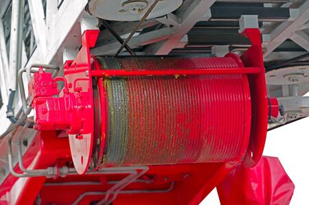 drum with a metal cable for lifting stairs on a fire truck