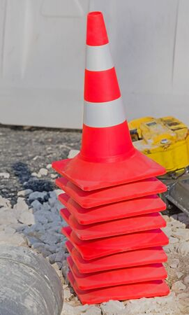 traffic cone with white and orange stripes on construction sites Фото со стока - 140244683