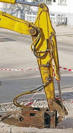 Hammer attached equipment for drilling and breaking on construction site Фото со стока