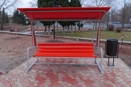 beautiful modern bench with protection from the rain in a city Park