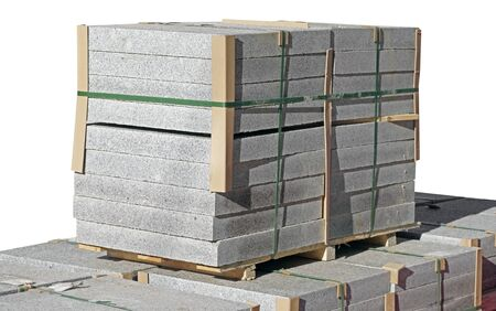 Tile blocks on pallets lie next to each other on white background Фото со стока - 140244687