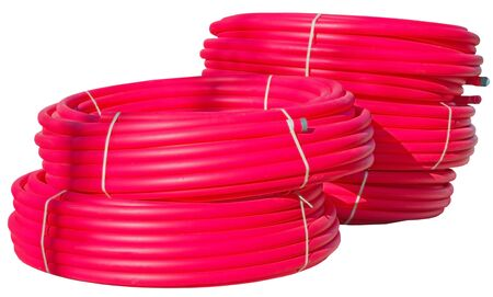 Many long red water plastic pipe for building on white background