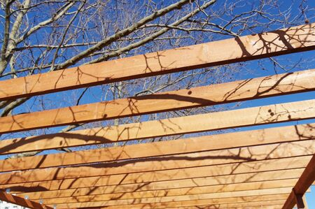 Wooden pavilion, wood pergola for sun protection in city parks Фото со стока - 140244771