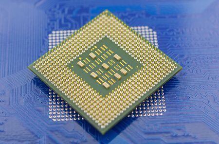 macro of computer processor on blue motherboard circuit Фото со стока