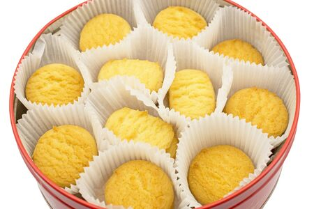 cookies in a round metal box on white background Фото со стока