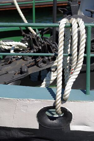 ship hawse on white hull with mooring ropes Stok Fotoğraf