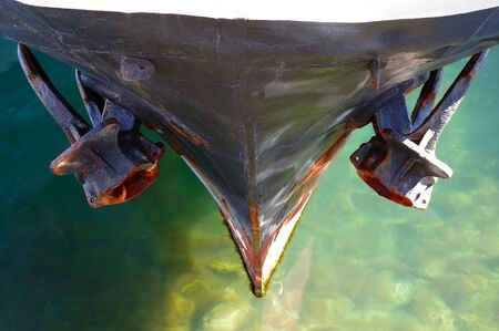 the Bow of a old boat with anchor