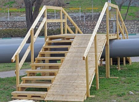the new wooden staircases with railings