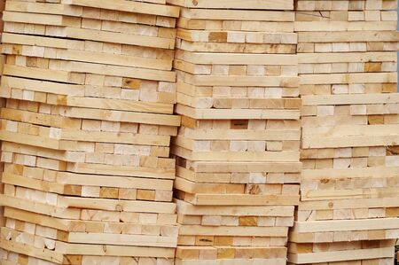 Wooden planks, lining, boards for construction works Фото со стока