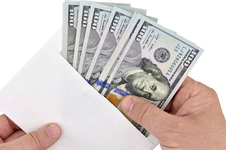 Pulling Money Out of a Envelope on white background