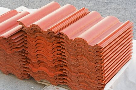 Orange roof tiles laid on many stacked in layers