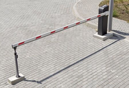Automatic barrier gates to entry the courtyard of the building
