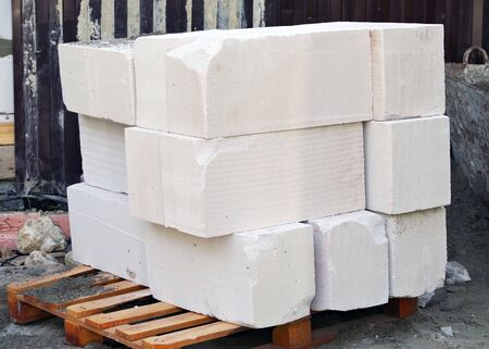 the white stone blocks on pallets lie next to each other