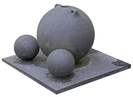 black cannonballs on a white background