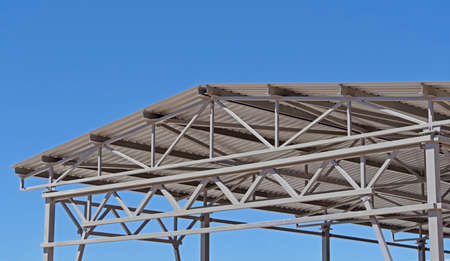 Structure of steel for building construction on sky background