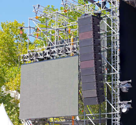 Big professional loud speaker system mounted on open air concert for powerful sound