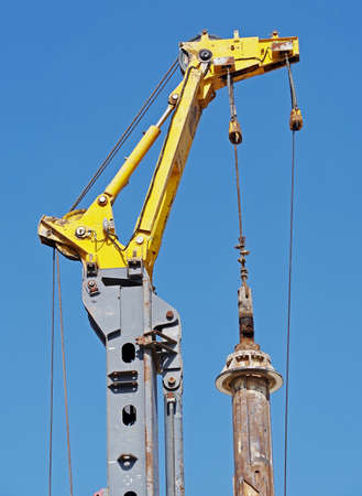 the pile driving machine on a background blue sky
