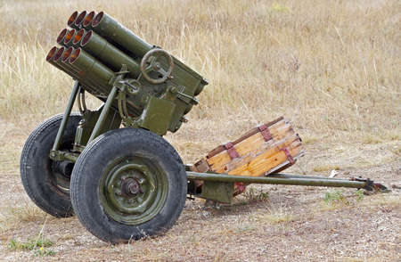 Old mobile rocket launcher at the position in the field