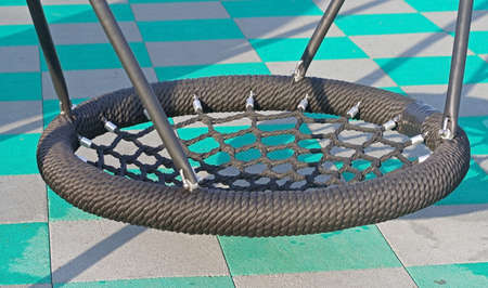 Modern new Swing basket in a playground close up