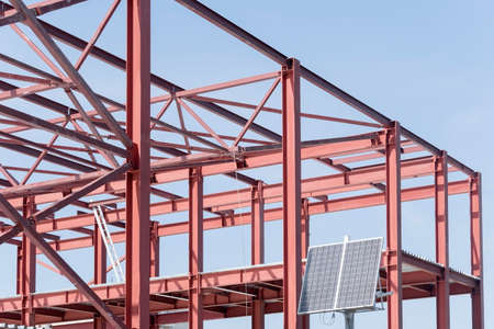 Steel Frames of A Building Under Construction on a background blue sky