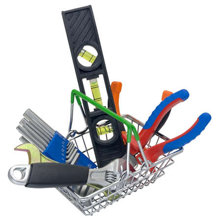 Shopping cart full of construction tools on white background