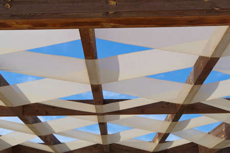 Wooden pavilion, wood pergola for sun protection on the beach