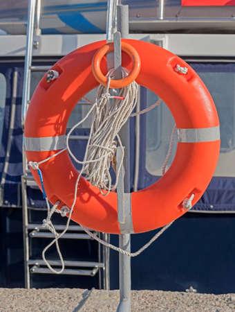 Lifebuoy hanging on a pole on the pier Zdjęcie Seryjne